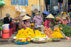 Vietnamese women selling flowers at the street